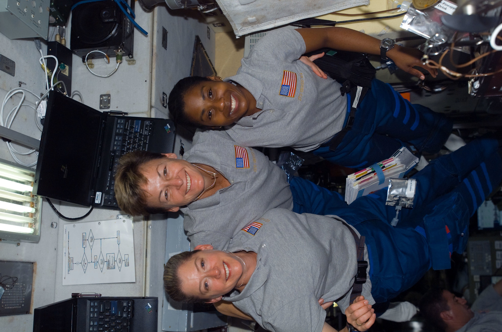 S120E008338 - STS-120 - STS-120 and Expedition 16 crew in Zvezda module