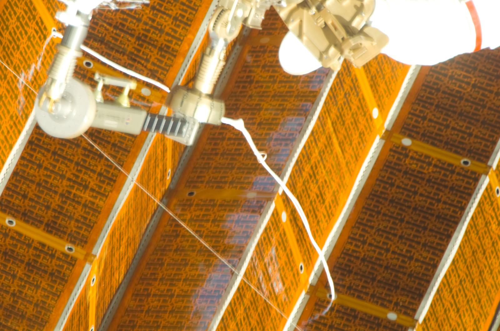 S120E008412 - STS-120 - EVA 4 - P6 4B solar array repair