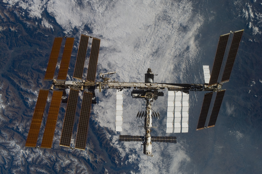 S120E008554 - STS-120 - Fly-around view of the ISS by the STS-120 crew