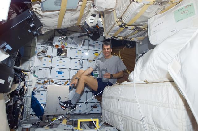 S120E010521 - STS-120 - Nespoli exercises on middeck