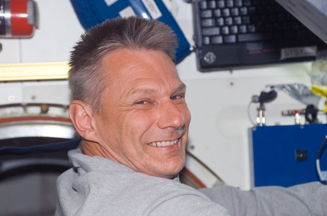 S121E06114 - STS-121 - Sellers smiles at the camera as he works on the MDK on STS-121 / Expedition 13 joint operations