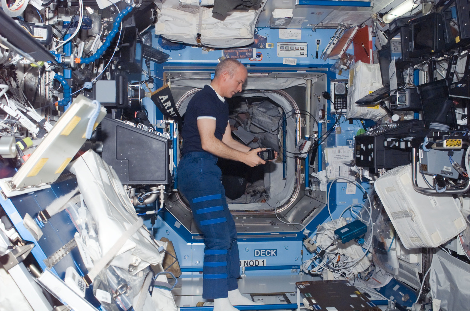 S121E06236 - STS-121 - Williams with camera flash in the U.S. Lab during STS-121 / Expedition 13 joint operations