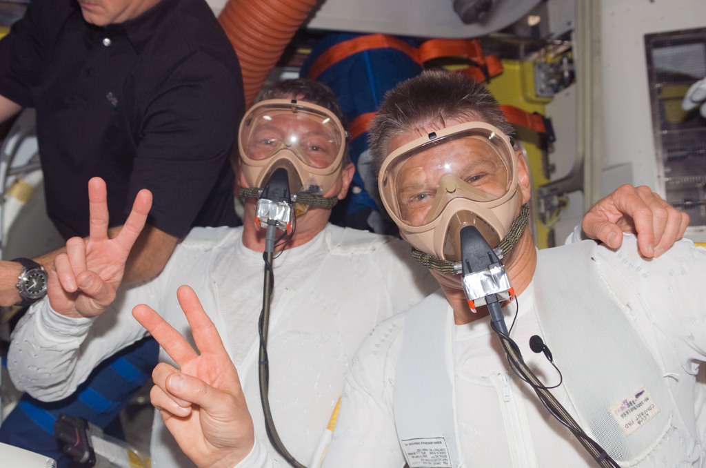 S121E06280 - STS-121 - Fossum and Sellers wear quick don mask during prebreath OPS for EVA 2 for STS-121 / Expedition 13 joint operations