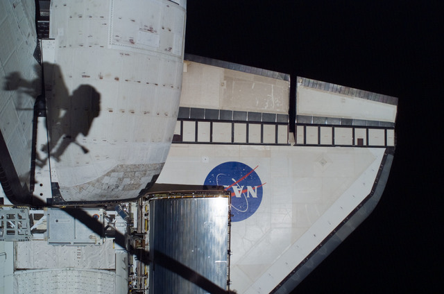 S121E06393 - STS-121 - EVA crewmembers shadows on the port OMS pod taken on EVA1 during STS-121 / Expedition 13 joint operations