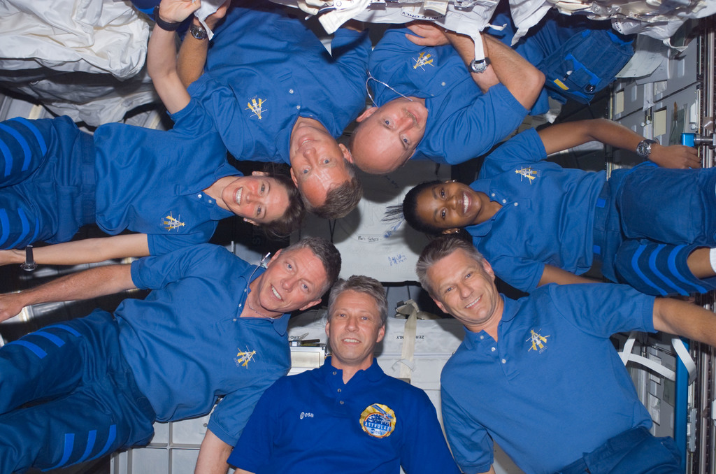 S121E07024 - STS-121 - STS-121 crew photo taken in the U.S. Lab during STS-121 / Expedition 13 joint operations