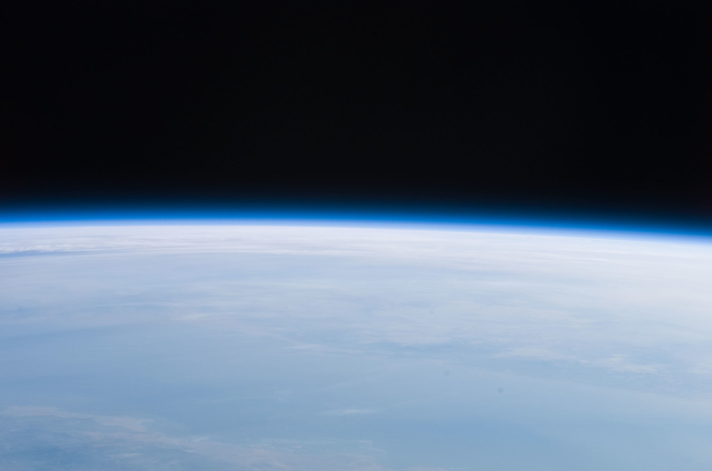 S121E07400 - STS-121 - Hazy Earth limb view taken during STS-121 / Expedition 13 joint operations