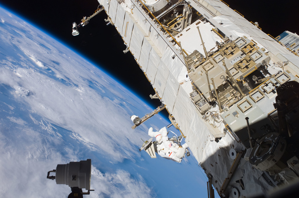 S121E07413 - STS-121 - Sellers translates along the S1 Truss during EVA3 on STS-121 / Expedition 13 joint operations