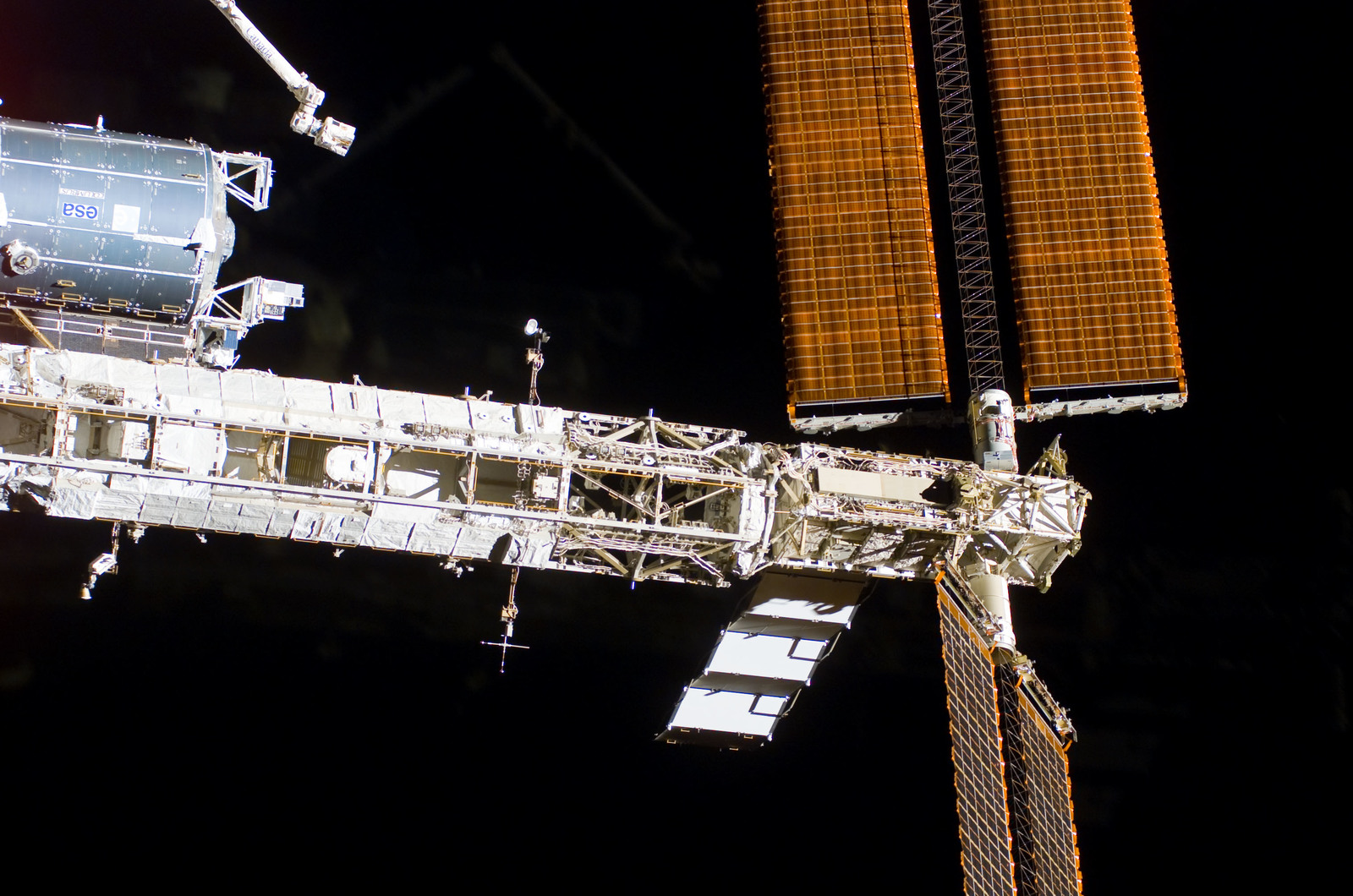 S122E009936 - STS-122 - Flyaround view of ISS after STS-122 Undocking