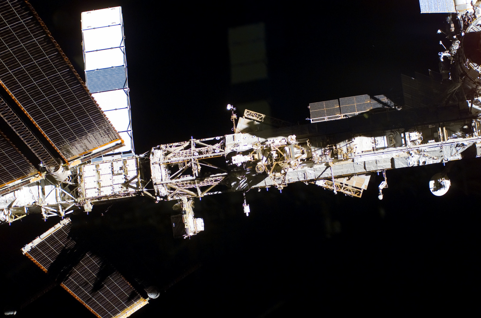 S122E009949 - STS-122 - Flyaround view of ISS after STS-122 Undocking