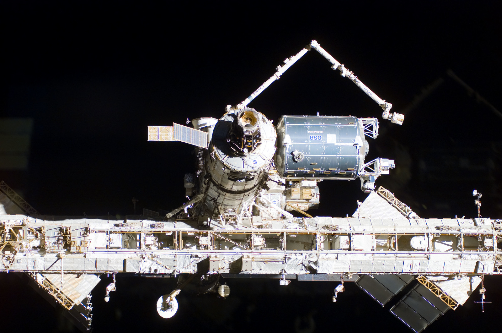 S122E009950 - STS-122 - Flyaround view of ISS after STS-122 Undocking