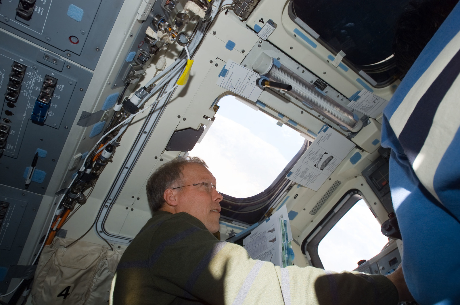 S123E005624 - STS-123 - Gorie at the aft FD window during STS-123 mission