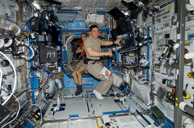 S123E006257 - STS-123 - STS-123 Crewmembers work at Robotic Controls during STS-123 / Expedition 16 Joint Operations