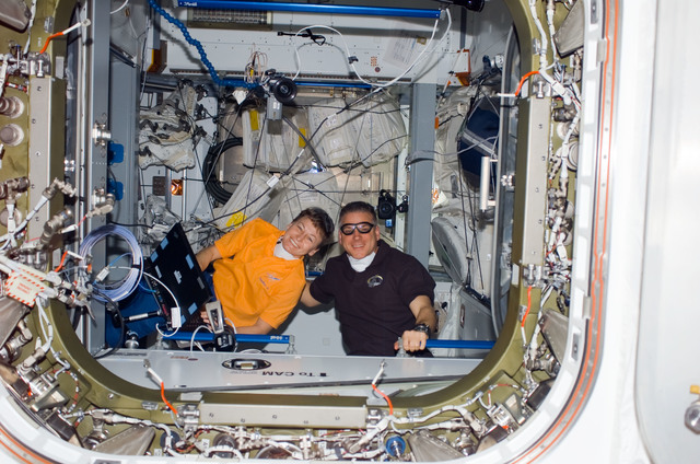 S123E006273 - STS-123 - Whitson and Johnson in the Node 2 hatch during STS-123 / Expedition 16 Joint Operations