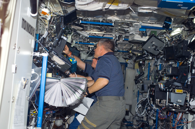 S123E006443 - STS-123 - Johnson works the controls of Robotic Canadarm2 in the U.S. Laboratory during Joint Operations