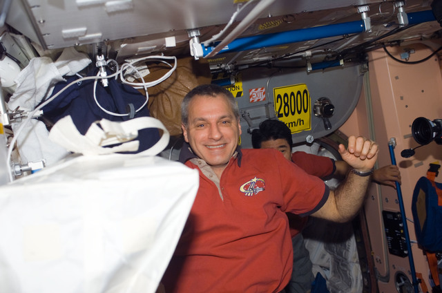 S123E006587 - STS-123 - Linnehan and Doi in the Node 1 during Joint Operations