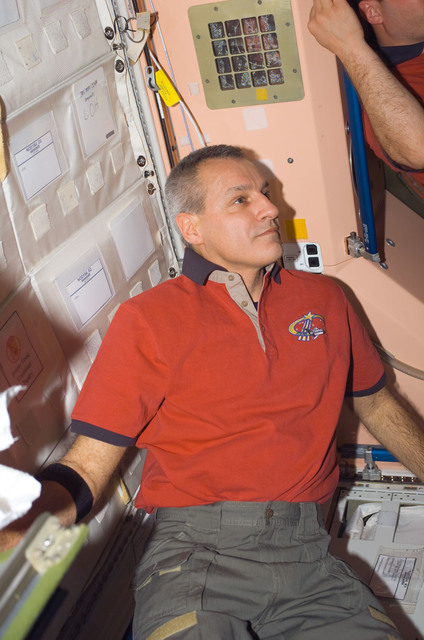 S123E006598 - STS-123 - Linnehan in the Node 1 hatch area during Joint Operations