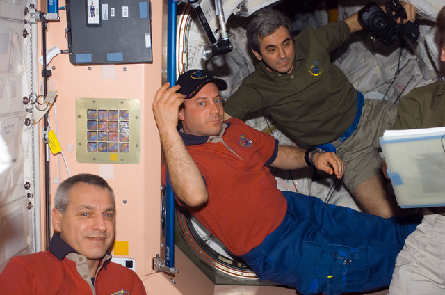 S123E006599 - STS-123 - Linnehan, Reisman, and Eyharts in the Node 1 hatch area during Joint Operations