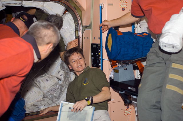 S123E006602 - STS-123 - Expedition 16 and STS-123 Crewmembers in the Node 1 hatch area during Joint Operations