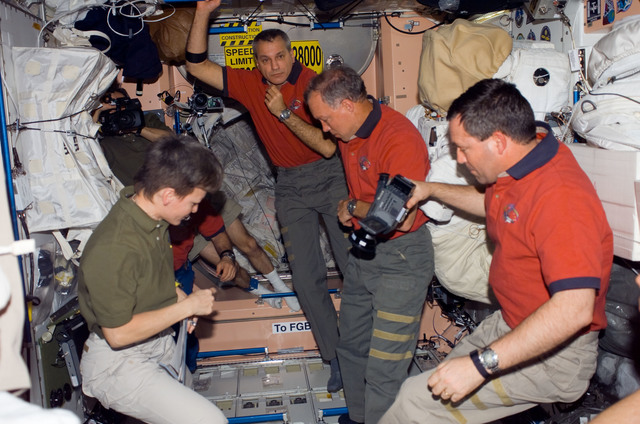 S123E006605 - STS-123 - Expedition 16 and STS-123 Crewmembers in the Node 1 hatch area during Joint Operations