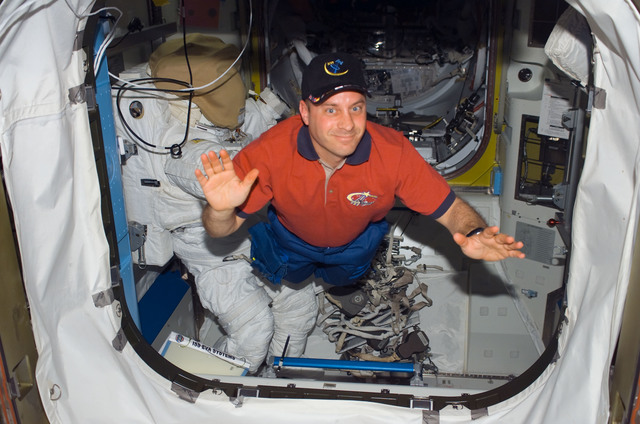 S123E006609 - STS-123 - Reisman in the Node 1 hatch area during Joint Operations