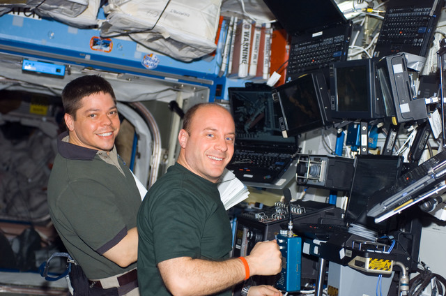 S123E006715 - STS-123 - Behnken and Reisman work the Robotic Canadarm2 controls in the U.S. Laboratory during Joint Operations