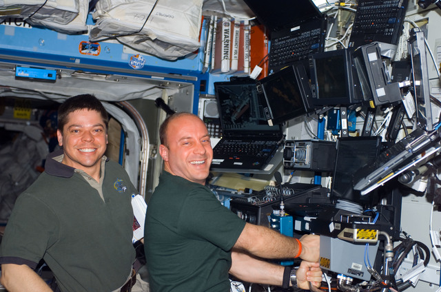 S123E006717 - STS-123 - Behnken and Reisman work the Robotic Canadarm2 controls in the U.S. Laboratory during Joint Operations