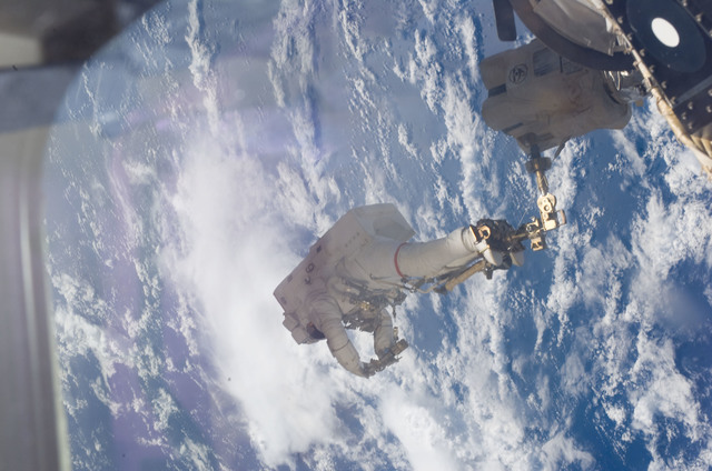 S123E006742 - STS-123 - Linnehan anchored to a Canadarrm2 mobile foot restraint during Expedition 16 / STS-123 Joint Operations