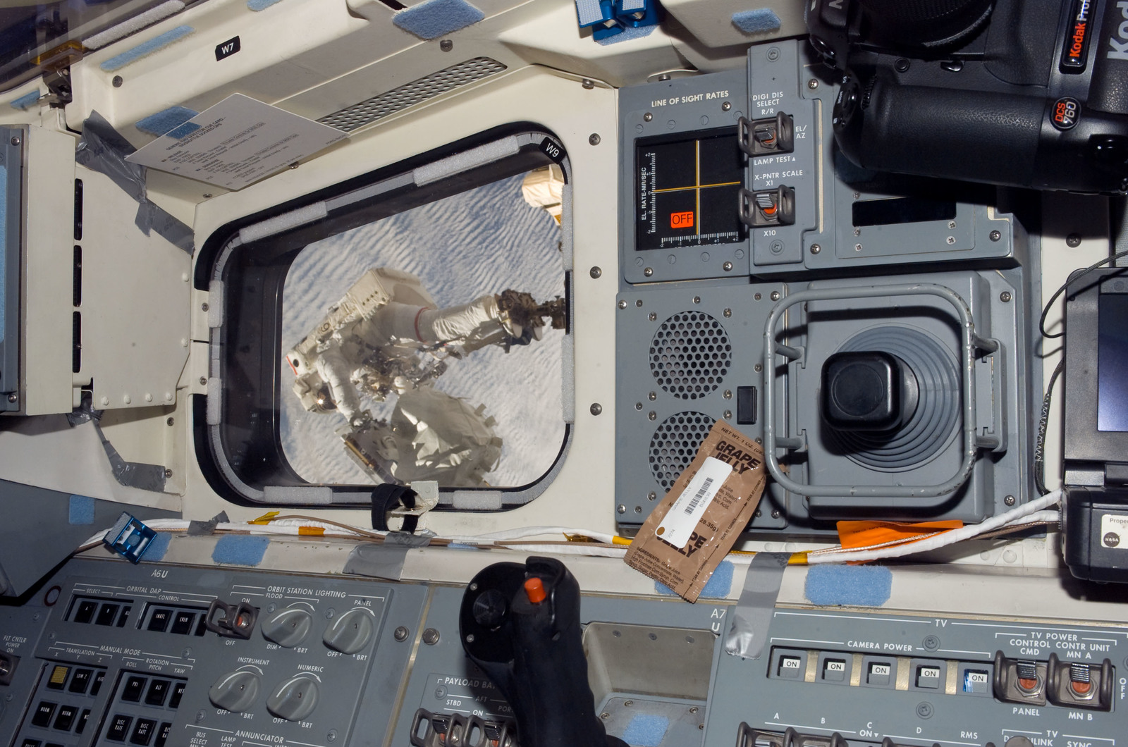 S123E006751 - STS-123 - Linnehan anchored to a Canadarrm2 mobile foot restraint during Expedition 16 / STS-123 Joint Operations