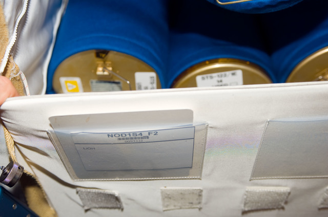 S123E007893 - STS-123 - CO2 Absorber Cartridges in the Node 1 during Joint Operations