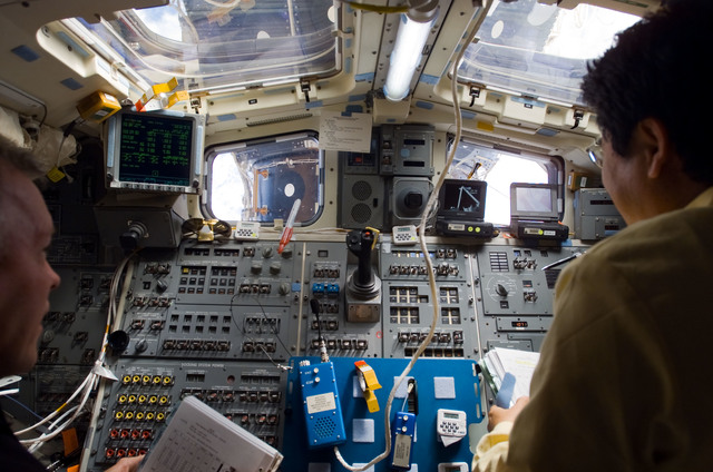 S123E008224 - STS-123 - Gorie and Doi look at crew procedures during Joint Operations