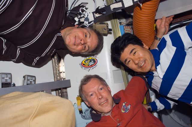 S123E008767 - STS-123 - Johnson,Gorie,and Doi pose in the A/L during Joint Operations
