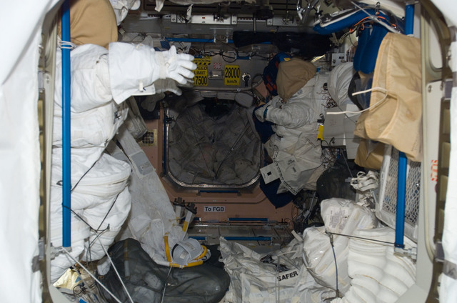 S123E008965 - STS-123 - EMUs and SAFEF in the Node 1 taken during Joint Operations