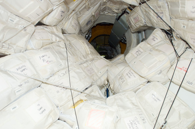 S123E008974 - STS-123 - Stowed bags in the hatch area taken during Joint Operations