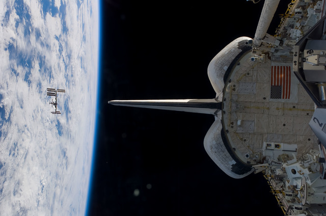 S123E009218 - STS-123 - Zenith view of the ISS during departure of STS-123 Space Shuttle Endeavour