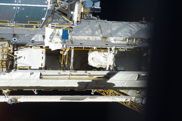 S123E009677 - STS-123 - Flyaround view of the ISS taken from STS-123 Space Shuttle Endeavor