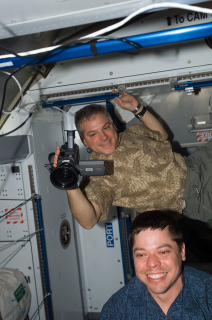 S123E009780 - STS-123 - Behnken and Johnson in the Node 2 during Joint Operations