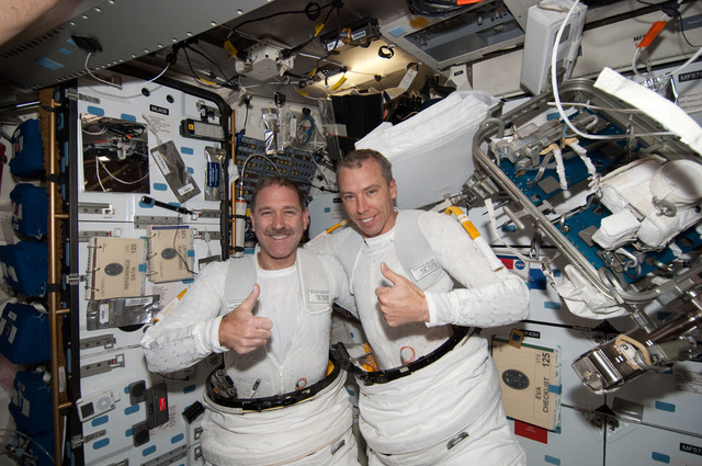 S125E008027 - STS-125 - STS-125 MS3 Grunsfeld and MS5 Feustel in the MDDK after EVA3