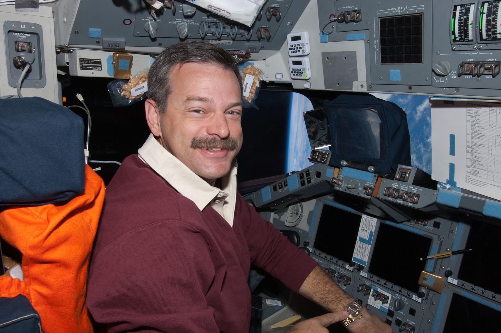 S125E013890 - STS-125 - View of STS-125 Commander Scott Altman on the Flight Deck