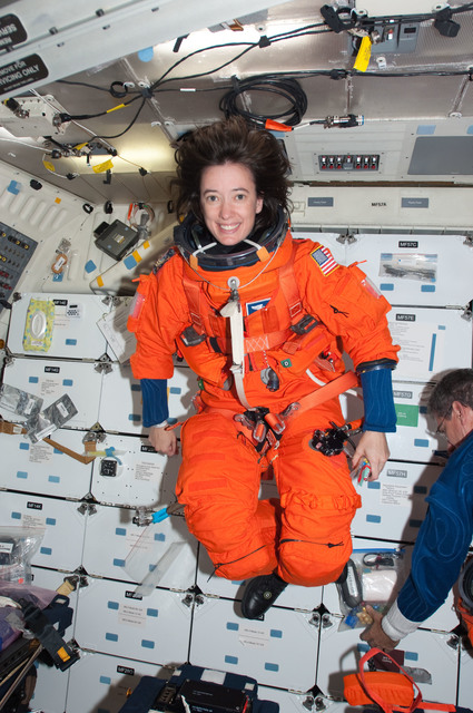 S125E014024 - STS-125 - View of MS Megan McArthur posing for a photo on the Middeck