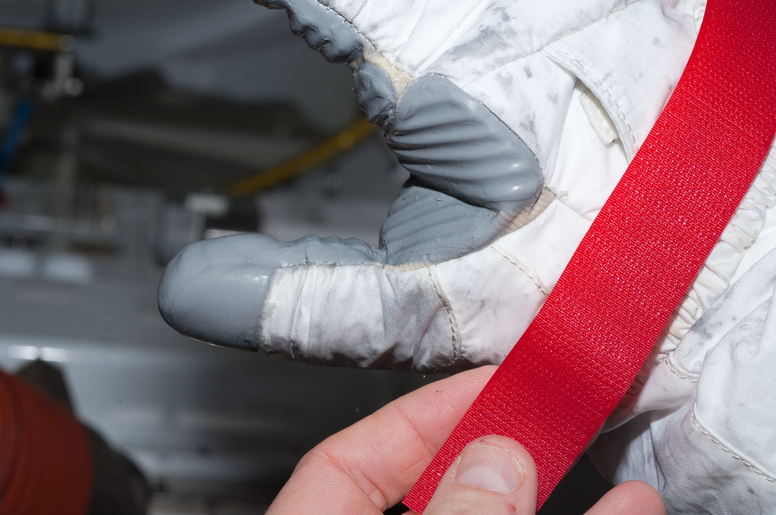 S126E007964 - STS-126 - Inspection of EMU Glove after EVA 1