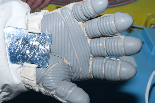S126E007969 - STS-126 - Inspection of EMU Glove after EVA 1