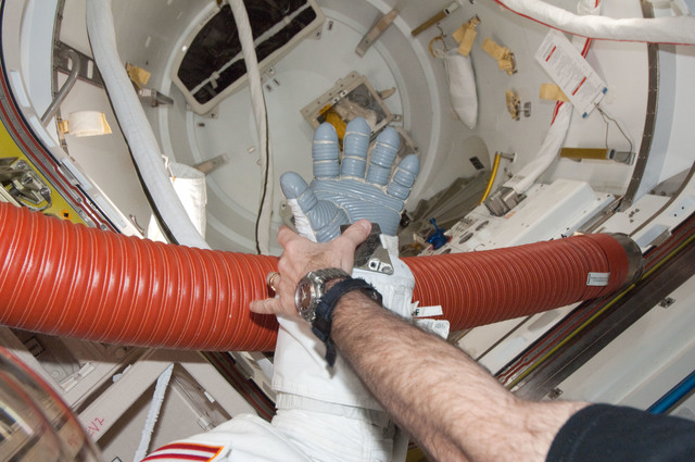 S126E008025 - STS-126 - EMU Glove Inspection in A/L