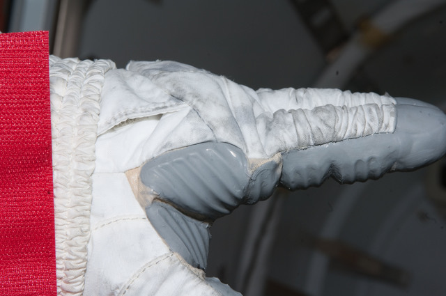 S126E008954 - STS-126 - Inspection of EMU Glove after EVA 3