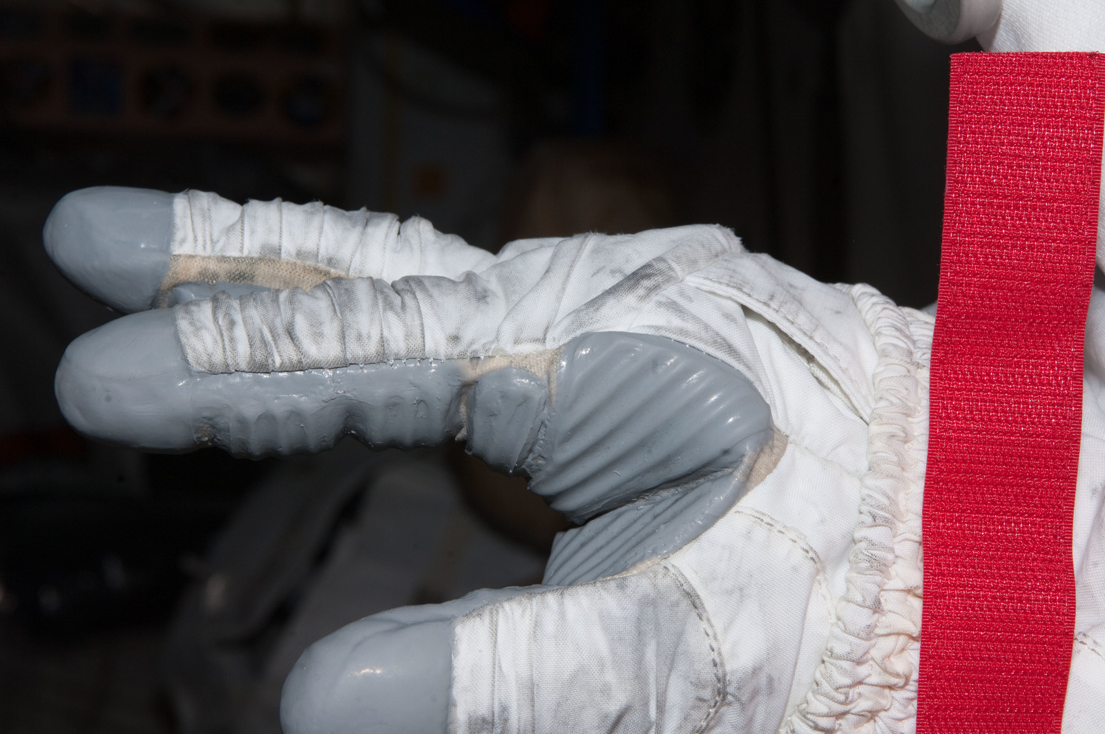 S126E008957 - STS-126 - Inspection of EMU Glove after EVA 3