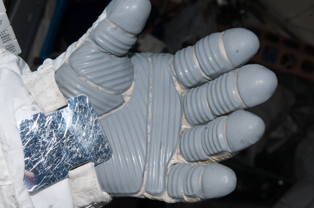 S126E008958 - STS-126 - Inspection of EMU Glove after EVA 3