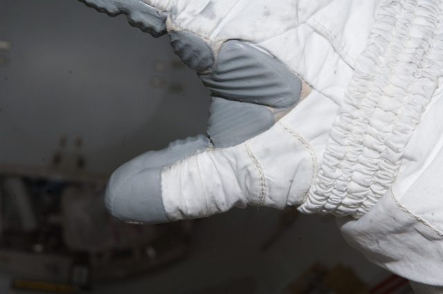 S126E008962 - STS-126 - Inspection of EMU Glove after EVA 3