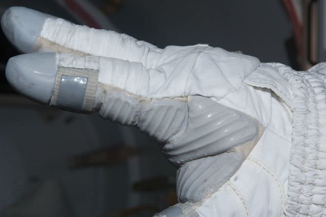 S126E009443 - STS-126 - Inspection of EMU Glove after EVA 4