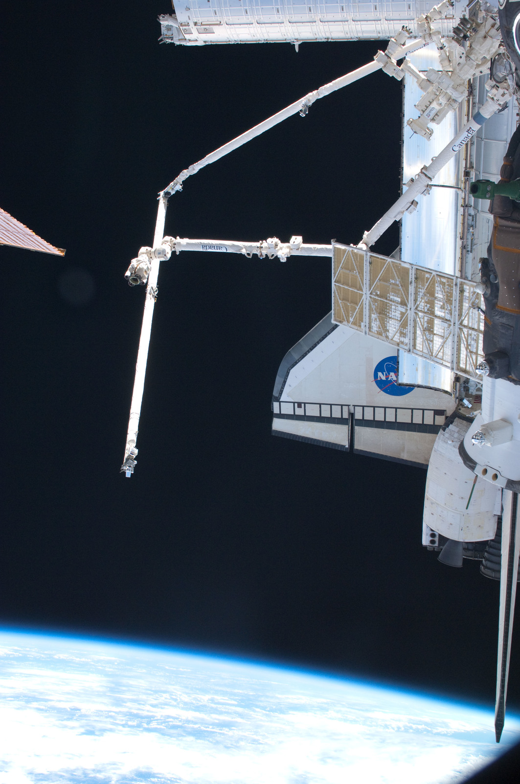 S126E024851 - STS-126 - View of Docked Soyuz, Endeavour, MSS and SRMS/OBSS