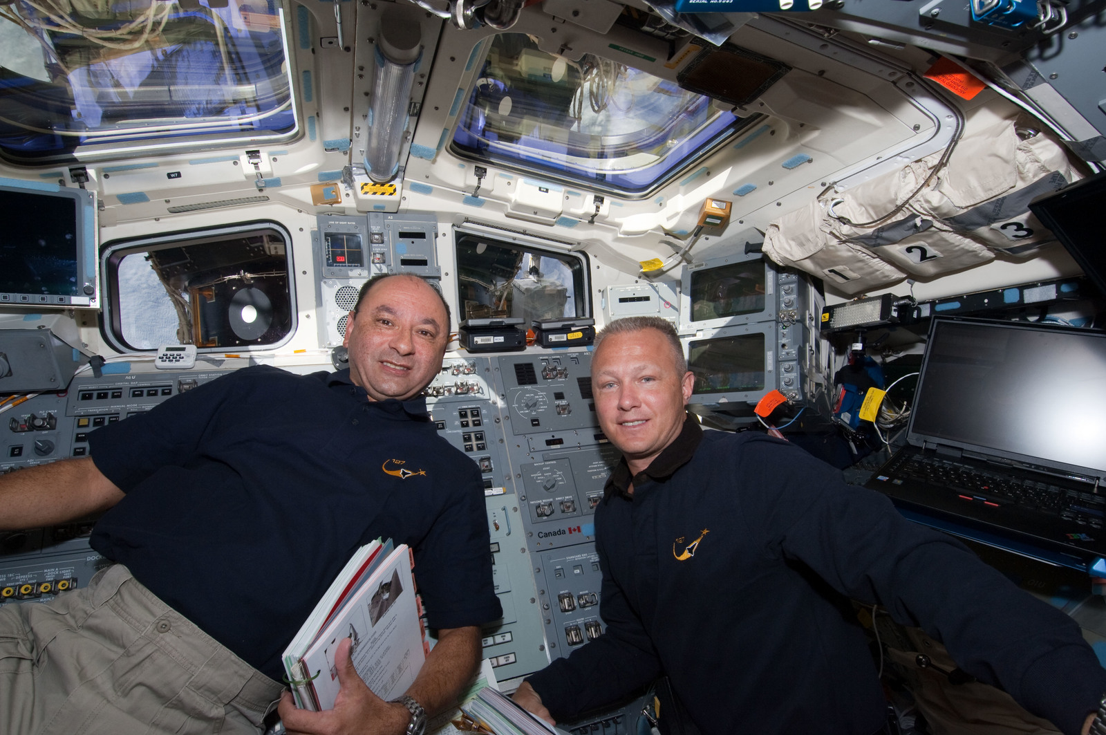 S127E006923 - STS-127 - Polansky and Hurley in the aft FD during STS-127 / Expedition 20 Joint Operations