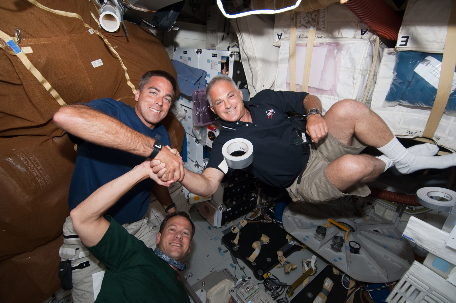 S127E006967 - STS-127 - Cassidy,Marshburn,and Wolf in the MDDK during STS-127 / Expedition 20 Joint Operations